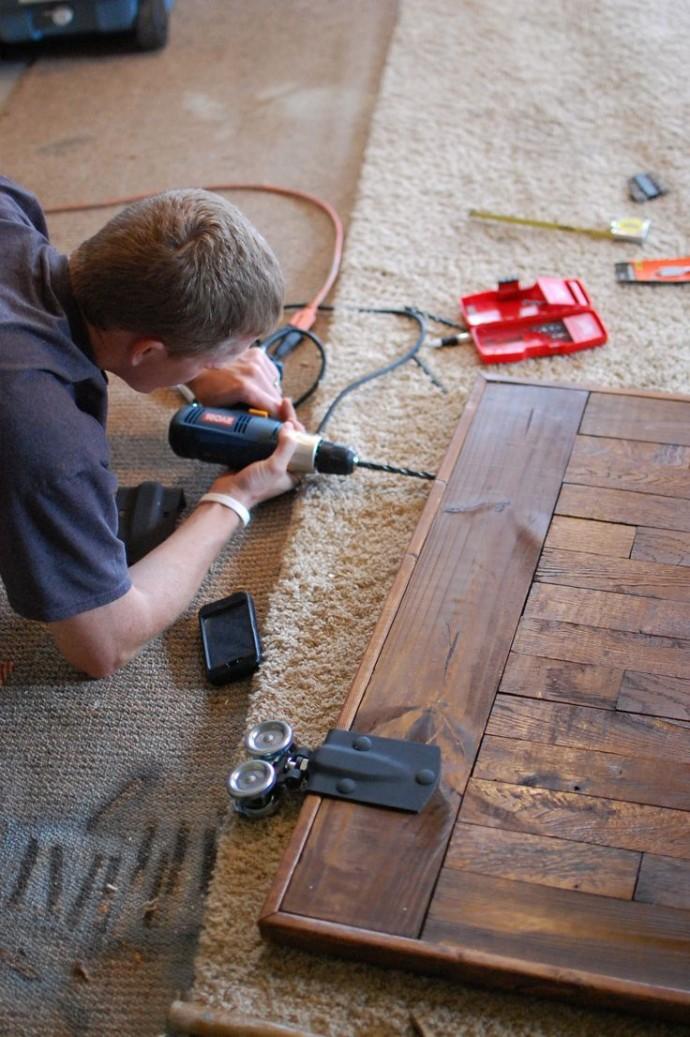 Rustic wooden doors being installed