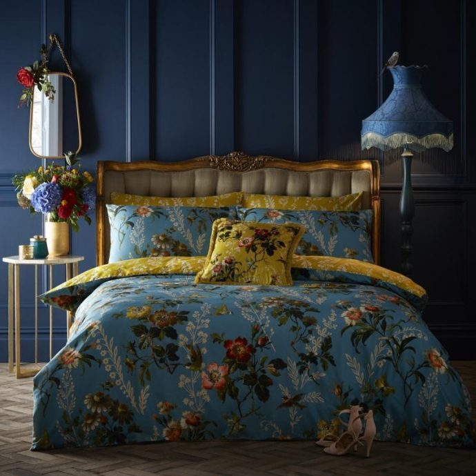 Blue painted walls. Blue and yellow flowery bedding