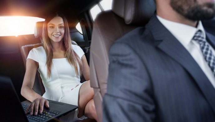 Business women  in chauffeur driven car
