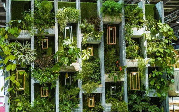Plants on large concrete shelf. Plant wall.